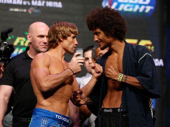 Faber e Cáceres na encarada da pesagem do UFC 175 | Foto: reprodução