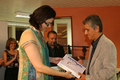 Jornalista Luciana Dummar, presidente do Grupo de Comunicação O POVO, dá posse ao novo ombudsman Paulo Rogério